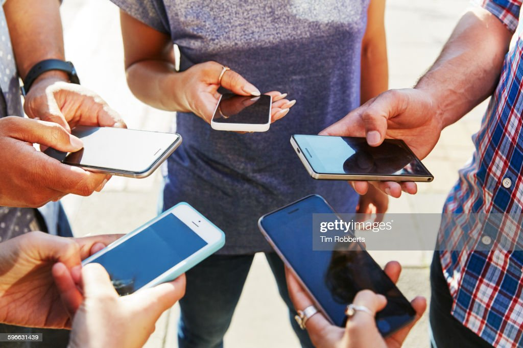 5 friends with smartphones, close up. : Stock Photo