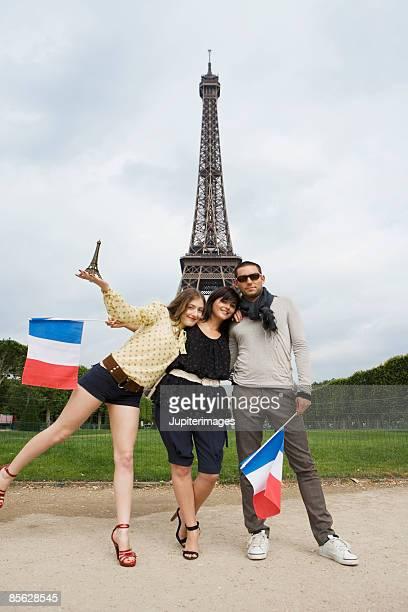 Friends with souvenirs near Eiffel Tower in Paris,  France