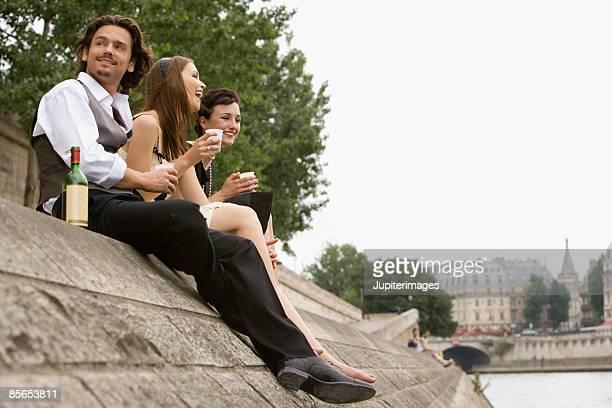 Friends with wine , River Seine , Paris , France