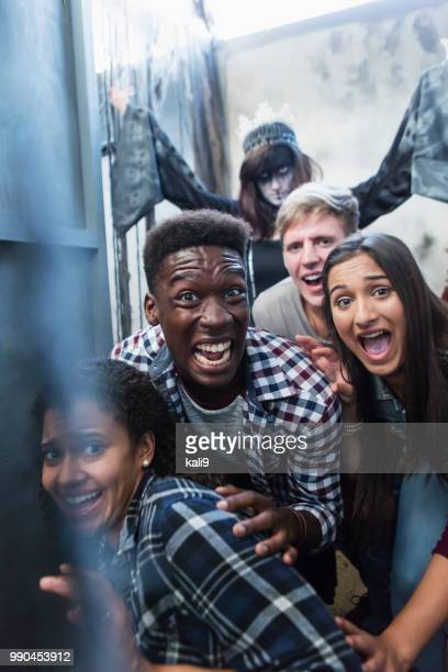 friends with zombie in halloween haunted house - zombie girl stock photos and pictures