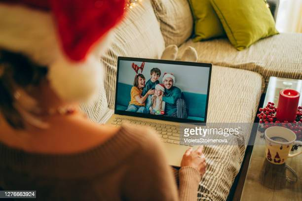 friends/family in christmas video call. - remote location stock pictures, royalty-free photos & images