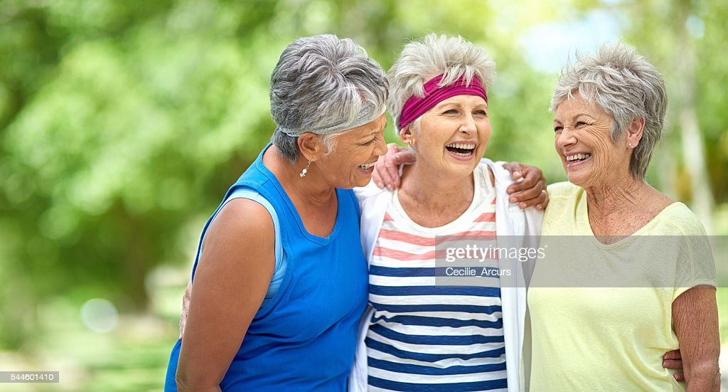 Friendship and fitness keep the heart young : Stock Photo