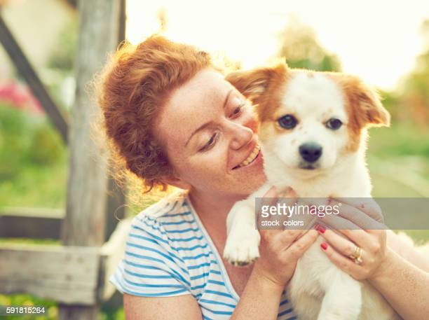 friendship and love - mongrel dog stock pictures, royalty-free photos & images