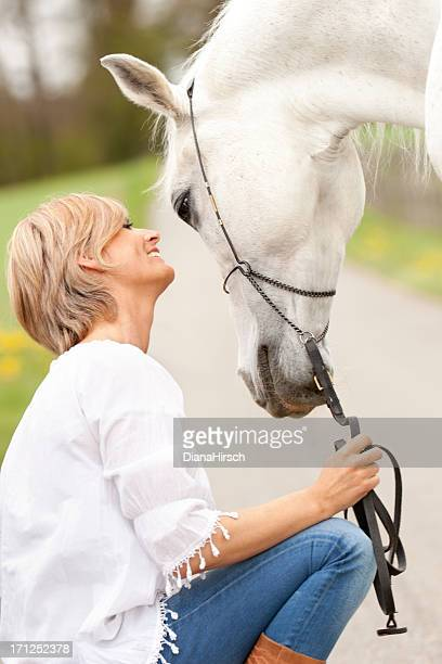 friendship between woman and white horse