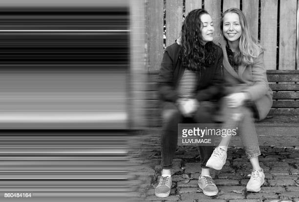 Friendship bond, two sisters in a public park.