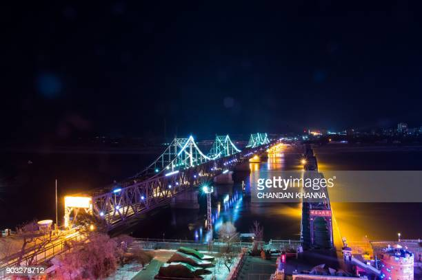 Friendship Bridge and Broken Bridge which lead to North Korea are seen from Dandong China's northeastern Liaoning province on January 10 2018 / AFP...