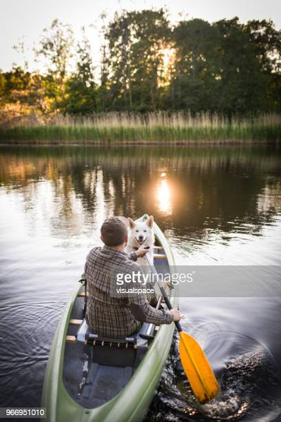 friendship on a canoe trip - wonderlust stock pictures, royalty-free photos & images