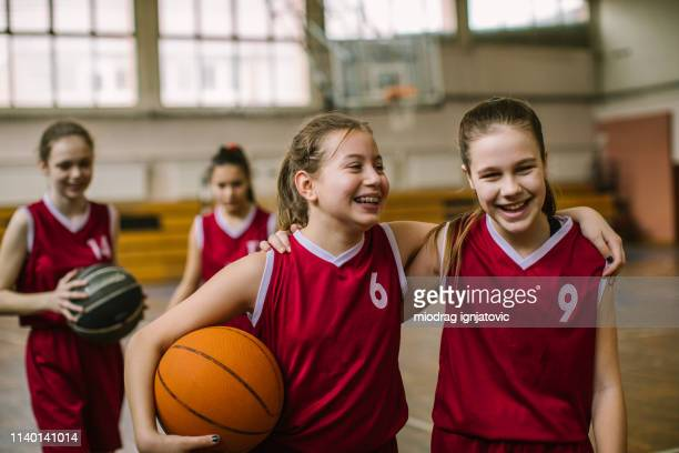 friendship on basketball court - pre adolescent child stock pictures, royalty-free photos & images