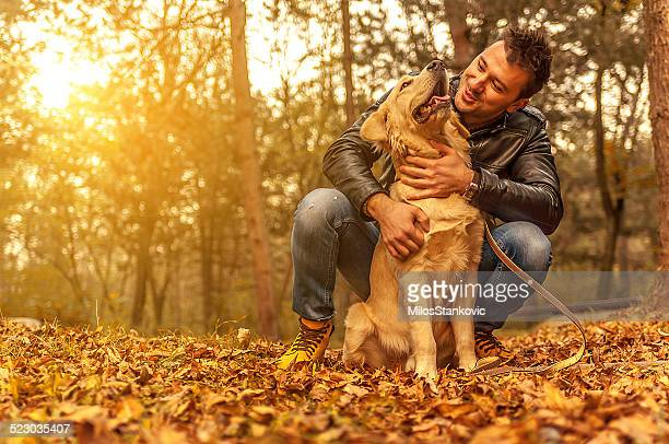 friendship - autumn dog stock pictures, royalty-free photos & images
