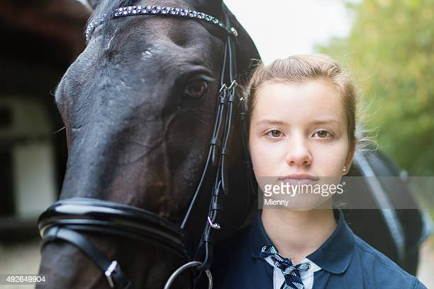 Friendship Teenage Girl together with her Black Horse