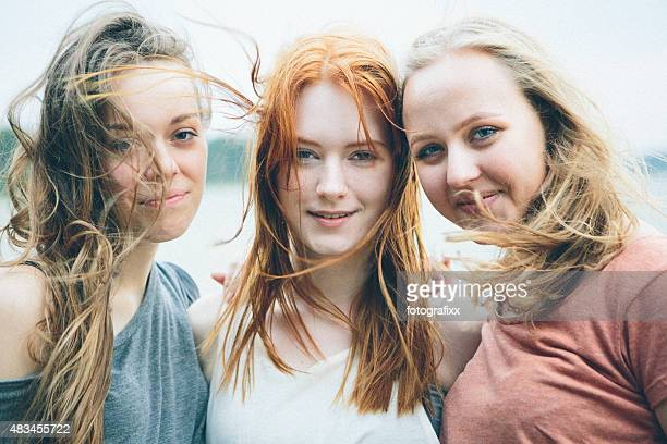 friendship: three cheerful female teenager on nature background - lake auburn stock photos and pictures