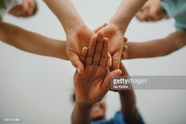 friendship unity. - human rights stock pictures, royalty-free photos & images