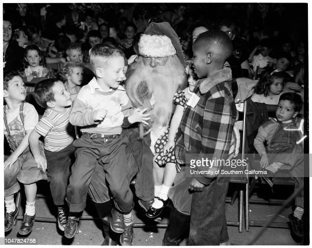 Friers' [sic] Christmas party 24 December 1953 Santa Claus with kidsCaption slip reads 'Photographer Lapp Date 1224 Reporter Brown Assignment Friars'...