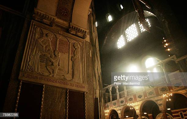 A frieze depicting Jesus Christ hangs in Westminster Cathedral during Ash Wednesday Mass is held at Westminster Cathedral on February 21 2007 in...