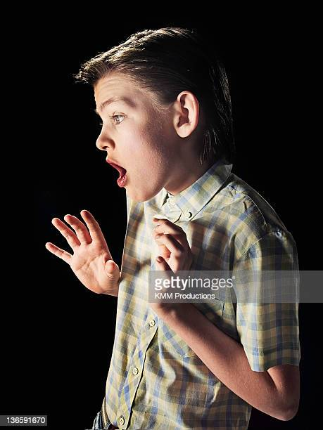 Frightened boy gasping