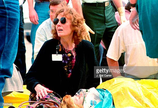 Frightened civilians react to the terrorist bombing at the Alfred P Murrah Federal Building in Oklahoma City April 19 1995 killing 168 people