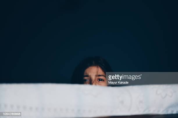 frightened girl hiding herself - child abuse stock pictures, royalty-free photos & images