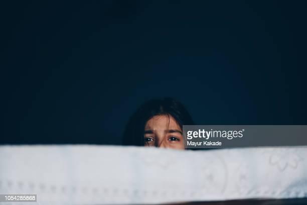 Frightened girl hiding herself