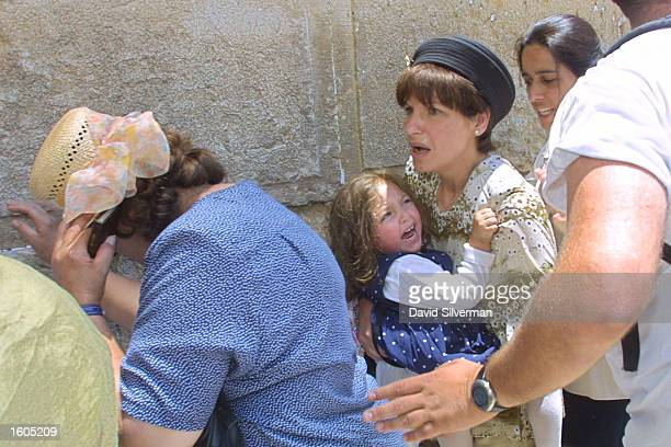 Frightened Jewish women and children are evacuated from the Western Wall in Jerusalem''s Old City after Palestinians rained stones down from the...
