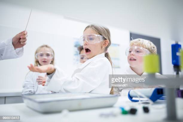 Frightened schoolgirl in science class