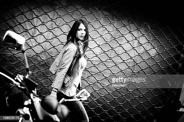 frightened woman running down a dark street - women black and white motorcycle stock pictures, royalty-free photos & images