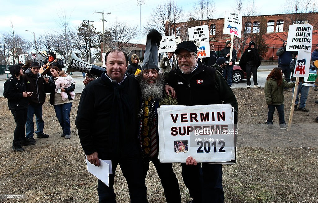 0ae2175d45b Fringe candidate Vermin Supreme poses for a photo with fans while ...