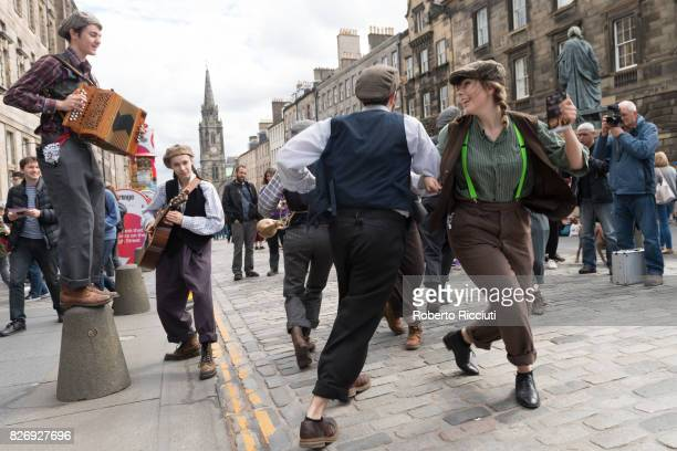 Fringe festival company Babolin Theatre promote their show 'Phools' entertaining people on the Royal Mile during the third day of the annual...