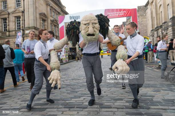 Fringe festival company Gruffdog Theatre promote their show 'Peer Gynt' entertaining people on the Royal Mile during the third day of the annual...