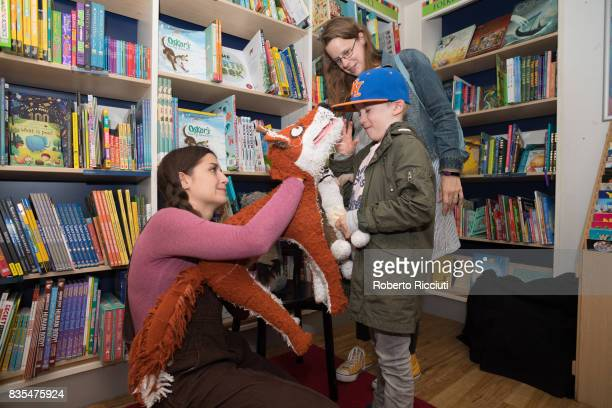 Fringe festival Performer Natasha Granger of Theatre Fideri Fidera and Oskar pelushi puppy entertains a young fan during a photocall to celebrate the...