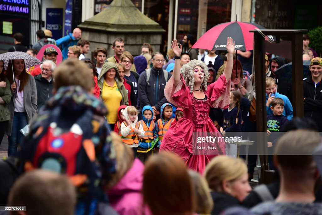 Fringe-goers and performers brave the rain during the Edinburgh Festival Fringe, on August 16, 2017 in Edinburgh, Scotland. The Fringe is celebrating its 70th year, and this year hosts over three thousand shows and more than 50,000 performances.
