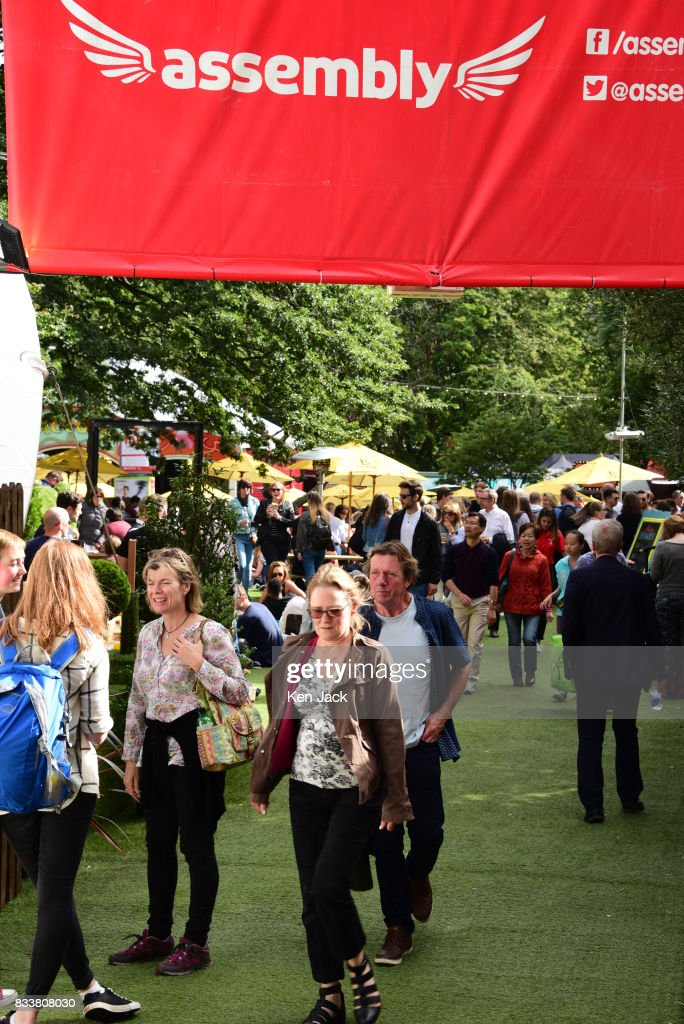 Fringe-goers enjoy the sunshine in the Assembly Gardens, one of the off-street venues for the Edinburgh Festival Fringe, on August 17, 2017 in Edinburgh, Scotland. The Fringe is celebrating its 70th year, and this year hosts over three thousand shows and more than 50,000 performances.