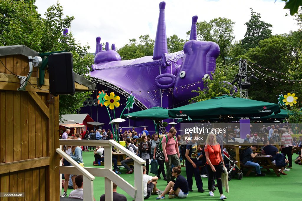 Fringe-goers enjoy the sunshine in the Underbelly Pasture, one of the off-street venues for the Edinburgh Festival Fringe, on August 17, 2017 in Edinburgh, Scotland. The Fringe is celebrating its 70th year, and this year hosts over three thousand shows and more than 50,000 performances.
