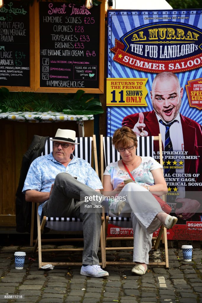 Fringe-goers relax in the sunshine at a coffee stall during the Edinburgh Festival Fringe, on August 17, 2017 in Edinburgh, Scotland. The Fringe is celebrating its 70th year, and this year hosts over three thousand shows and more than 50,000 performances.