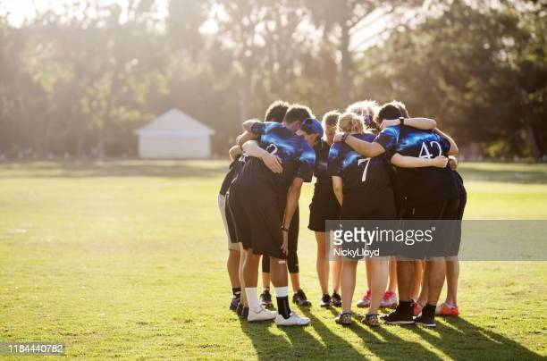 frisbee team pep talk - pep talk stock pictures, royalty-free photos & images