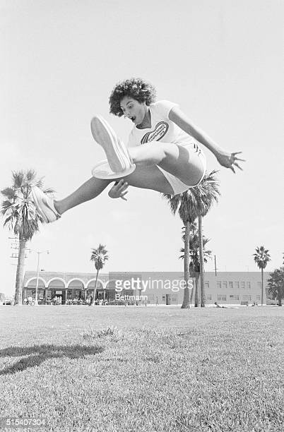 Frisbee World Champion Laura Engel jumps high in the air and makes a through the legs catch while she practices at Santa Monica beach. Miss Engel...