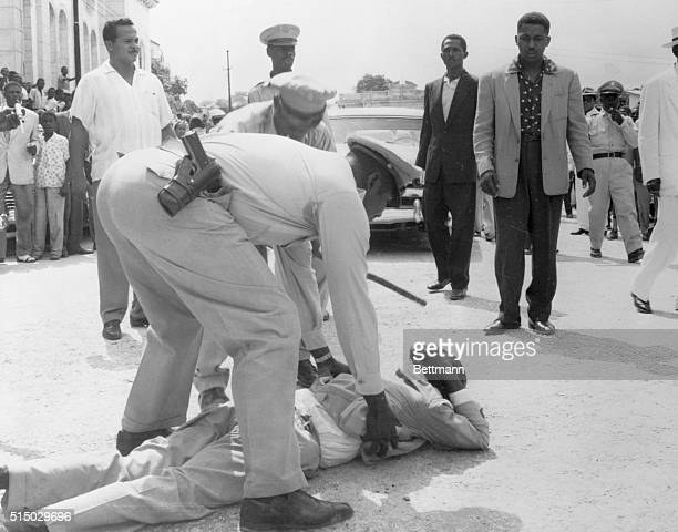 Frisked PortAuPrince Haiti A supporter of presidential candidate Francois Duvalier being searched by a policeman after demonstrating in PortAuPrince...