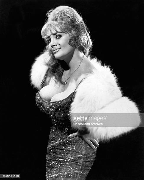 A frisky promotional portrait of burlesque dancer and stripper Mary Goodneighbor whose stage persona was 'Irma The Body' circa 1962