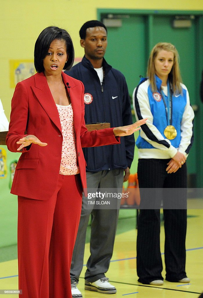 US Frist Lady Michelle Obama (L) makes remarks with 2010 Olympian speedskater Shani Davis (C) and mogul skier Hannah Kearney (R) during an event highlighting physical activity as a critical element of the 'Let's Move' initiative on April 21, 2010 in the North East section of Washington, DC. AFP PHOTO / Tim Sloan