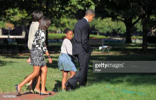 Frist lady Michelle Obama Malia Obama Sasha Obama and US President Barack Obama walk across LaFayette Park to St John's Episcopal Church on September...