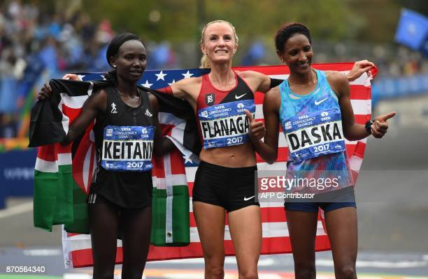 Frist place Shalane Flanagan of the US second place Mary Keitany of Kenya and third place Mamitu Daska of the US pose after the Women's Division in...