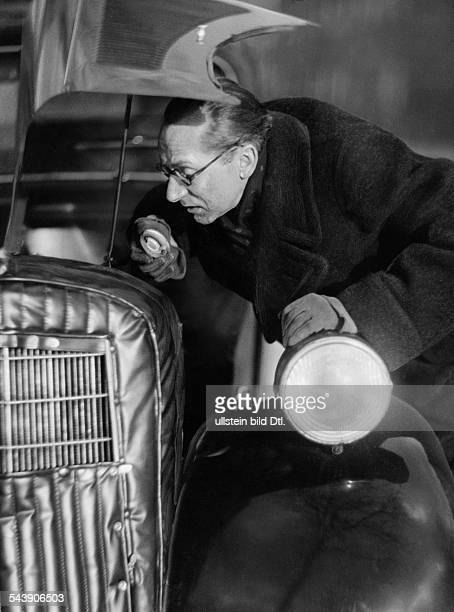 Fritz Bruno Comedian Actor Germany*0403190 is controlling his car Photographer Curt Ullmann Published by 'Sieben Tage' 03/1937Vintage property of...