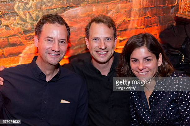 """Fritz Chesnut, and Oliver and Christy Mcirwin pose for a picture at the 2016 Outfest Los Angeles Closing Night Gala Of """"Other People"""" After Party at..."""