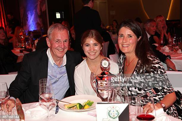 Fritz Egner and his daughter Lara Egner nd his wife Karin Egner attend the Monti Memorial Charity Gala at Hotel Vier Jahreszeiten on October 18 2014...