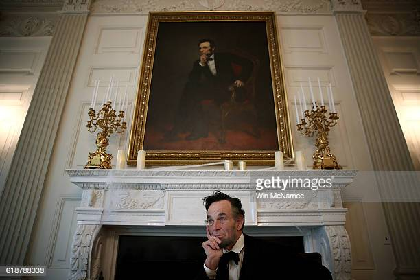 Fritz Klein, an actor playing the role of former U.S. President Abraham Lincoln, sits in character beneath the 16th president's portrait in the State...