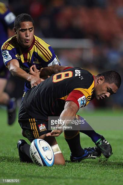 Fritz Lee of the Chiefs loses the ball as Lima Sopoaga of the Highlanders tackles during the round 12 Super Rugby match between the Chiefs and the...