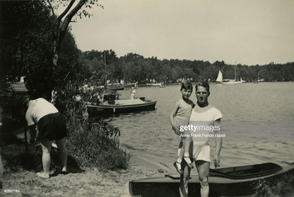 Fritz Pfeffer (1889 - 1944) by a lake in Berlin with his son Werner, May 1932. A Jewish refugee, he shared a hiding place with Anne Frank during the German occupation of the Netherlands.