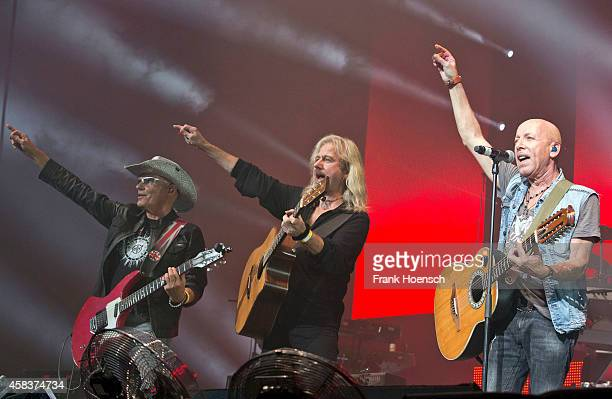 Fritz Puppel Bernd Roemer and Toni Krahl of the German bands City and Karat perform live during the concert Rock Legends at the O2 World on November...
