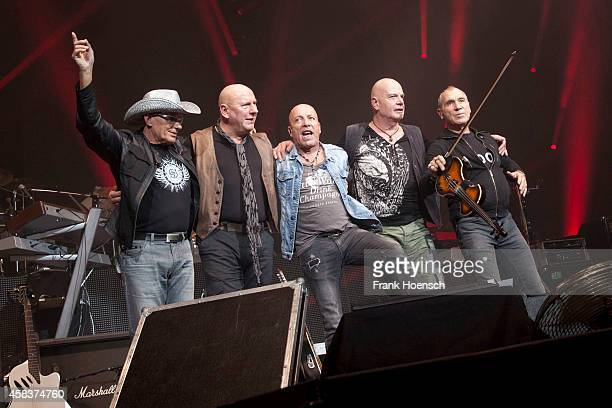 Fritz Puppel Manfred Hennig Toni Krahl Klaus Selmke and Georgi Gogow of the German band City perform live during the concert Rock Legends at the O2...