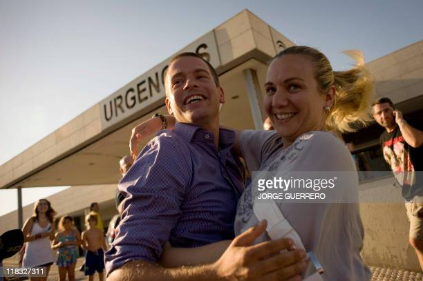 Fritz son of MaryAnne Goznes a Dutch woman hiker who spent 18 days trapped at the bottom of a ravine hugs a relative at the entrance of the hospital...