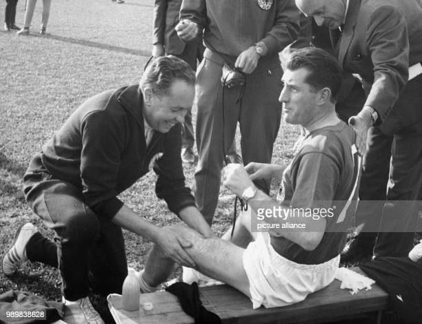 Fritz Walter is being prepared by massager Erich Deuser prior to the Bgame Switzerland Germany during the 1962 FIFA World Cup in Santiago de Chile on...